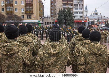 Soldiers on the square in black hats