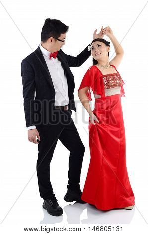 Portrait of young elegant enamoured just married groom and bride dancing at Wedding on isolated white background