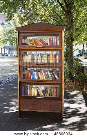 Hannover, Germany - September 7, 2016: A public bookcase serves as a free open air library.
