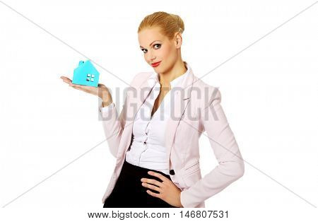 Smile business woman holding a paper house