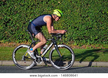 St Neots, Cambridgeshire, England - September 11, 2016: Triathlon Male competitor on road cycling stage of competition.