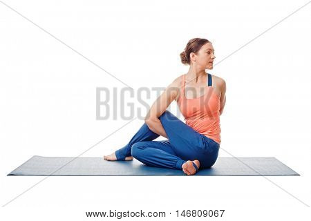 Woman doing Ashtanga Vinyasa Yoga asana  Marichyasana D - sitted spinal twist pose posture easy variation isolated on white background