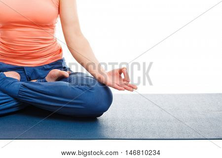 Close up of of woman in yoga asana Padmasana (Lotus pose) cross legged position for meditation with Chin Mudra - psychic gesture of consciousness isolated on white background with copyspace