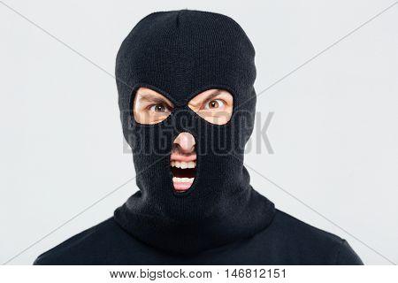 Portrait of mad furious man in balaclava