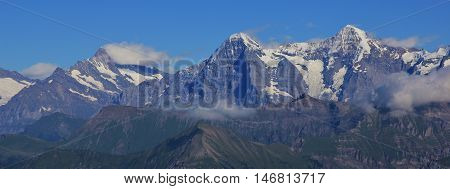 Eiger North Face. View from Mt Niesen. High mountains Finsteraarhorn Eiger and Monch in summer.