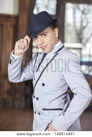 Confident Man Holding Hat While Performing Tango