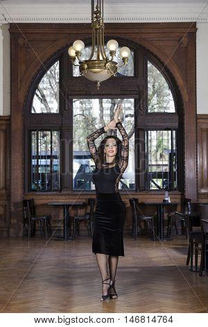 Beautiful Woman Performing Tango In Restaurant