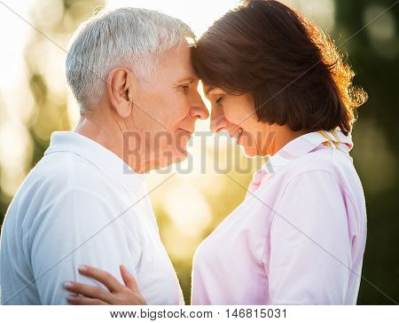 Closeup of happy senior couple spending quality time on tropical beach
