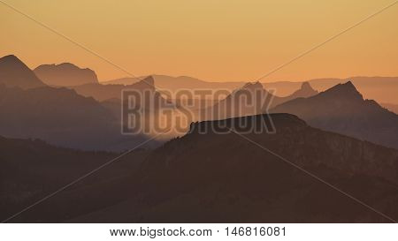View from Mt Niesen Bernese Oberland. Mountain ranges at sunset. Summer scene in the Swiss Alps.