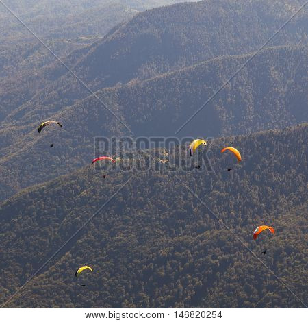 Paragliders Flying Over Mountains