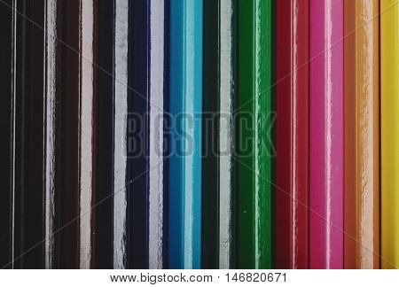 Backgroung of wooden colorful crayon