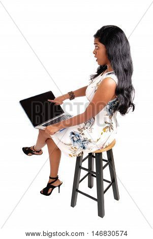 A scared Indian woman looking scared at her laptop what she see's at the screen isolated for white background.