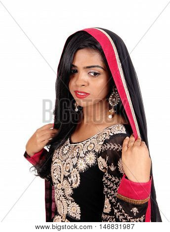 A gorgeous young Indian woman in a original Indian dress and long black hair standing in front isolated for white background.