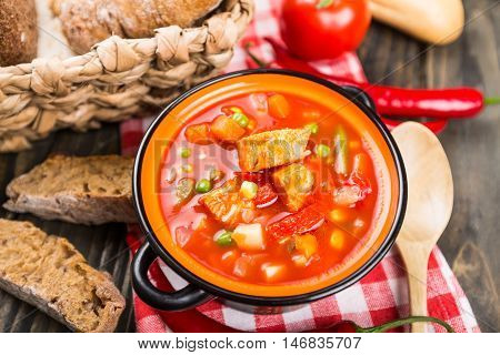 Stew soup with meat and vegetables in the pot