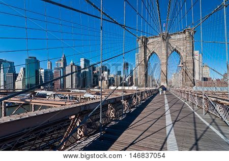 New York USA - November 18 2011: People crossing Brooklyn bridge in New York City at November 18 2011 the oldest suspension bridges in the United States.