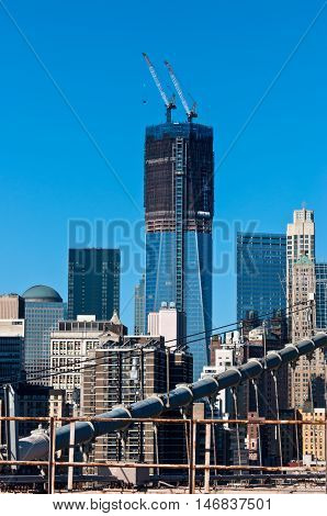 New York City USA - November 18 2011: New Freedom Tower under construction on the site of the World Trade Center at November 18 2011. View from the Brooklyn Bridge.