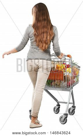 Portrait of a Woman Pushing a Shopping Cart Full of Groceries