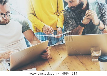 Business Startup People Brainstorming Process.Coworkers Making Great Decisions.Young Bearded Hipsters Team Discussion Corporate Work Concepts.Creative Manager Analyze Project Wood Table Modern Office