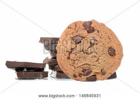 chocolate chip cookies and chocolate pieces isolated white background