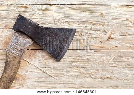 ax on a wooden background top view