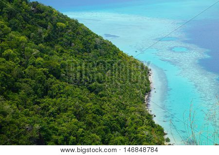National Park on top of Bohey Dulang island near Sipadan Island,Sabah,Borneo. Mirror smooth ocean surrounded by mountains. The bright blue water and rocky shore in the tropical island of Borneo.
