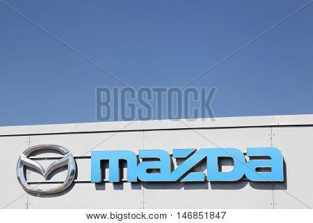 Fredericia, Denmark - September 10, 2016: Mazda logo on dealer facade. Mazda is a Japanese automaker based in Fuchu, Japan