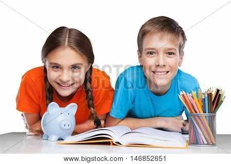 Two School Children with Piggy Bank and Textbooks