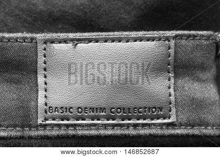 Black label lettered basic denim collection as a background