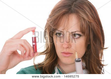 A young female health professional looking at a blood sample
