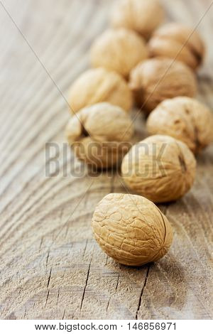 Walnuts on a wooden rustic board. Organic and diet food.