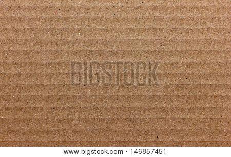 Texture of cardboard light brown color for design.