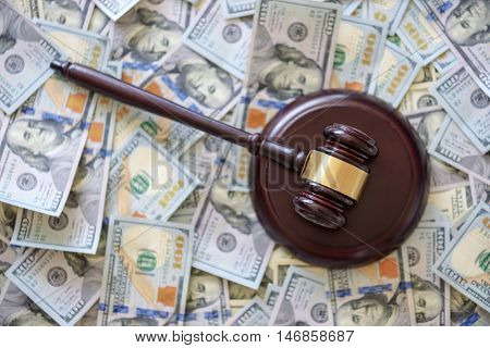 wood gavel on cash background