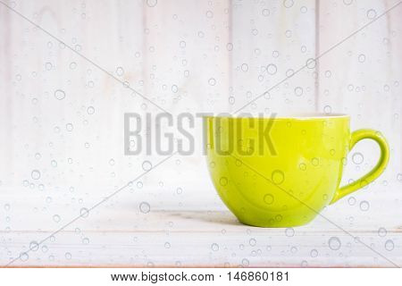 Coffee cup on a wooden floor .