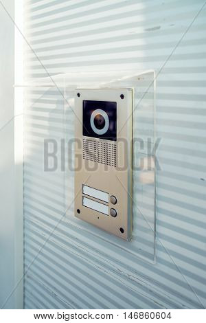 Video intercom device on building exterior wall for house entry and communication