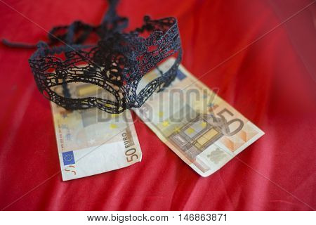 Sexy Mask With 50 Euro Banknot On Red Bed