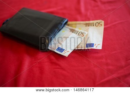 Wallet With Euro Banknot On Red Bed