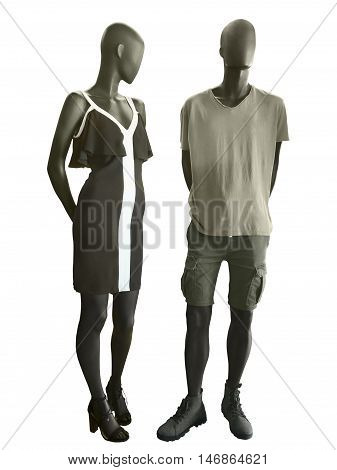 Two mannequins male and female dressed in casual clothes. Isolated on white background. No brand names or copyright objects.