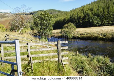 River Shee with fenced and tree festered banks