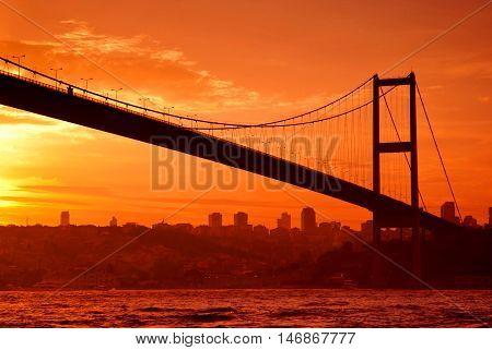 Bosphorus Bridge in Istanbul at sunset in orange tones