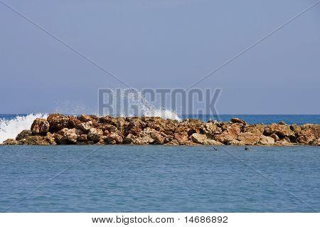 Waves Splashing Over A Rock Seawall