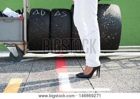 Black High Heels And Racing Tire