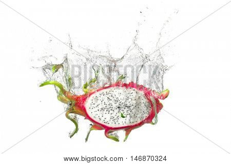 Dragon fruit  splashes into the water
