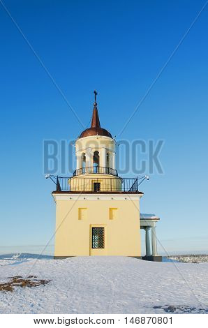 NIZHNY TAGIL RUSSIA - FEBRUARY 13 2016: The symbol of the city Nizhny Tagil Tower on top of a mountain in winter day