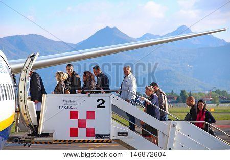 BERGAMO, ITALY - APRIL 25, 2016: Passengers boarding Ryanair aircraft at Orio Al Serio international airport