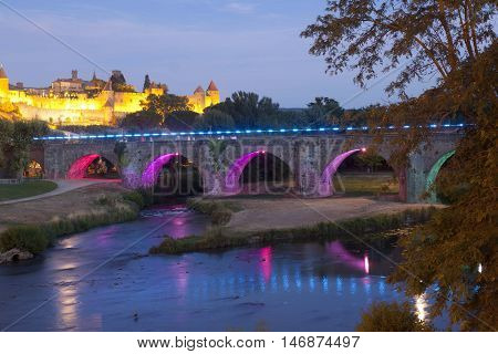 Carcassonne City And The Old Bridge At Night In France