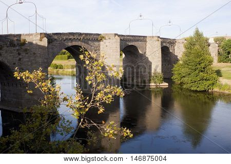 Old Bridge And Its Reflection In Carcassonne, France