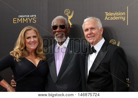 LOS ANGELES - SEP 11:  Lori McCreary, Morgan Freeman, James Younger at the 2016 Primetime Creative Emmy Awards - Day 2 - Arrivals at the Microsoft Theater on September 11, 2016 in Los Angeles, CA