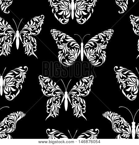 Seamless Pattern With Beautiful Butterflies Created From Abstract Floral Tracery On A Black Backgrou