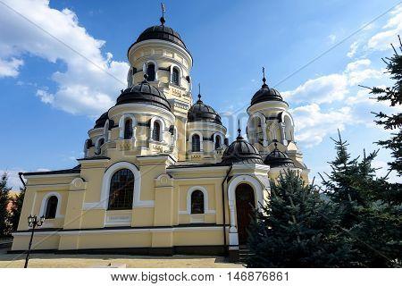 Photo of Capriana Monastery in Moldova with blue sky