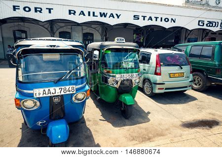 COLOMBO SRI LANKA - FEBRUARY 16 2016: Tuk tuk taxis parked in front of Colombo Fort train station. Tuk tuk and train are the most common transportation in Sri Lanka